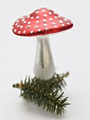 Christmas decoration (fly agaric) on sprig of fir