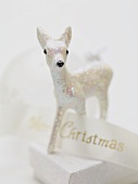 Christmas decoration (deer) on box with ribbon