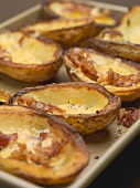 Baked potato skins with bacon (close-up)