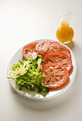 Sliced Tomatoes with Greens; Salad Dressing