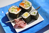 Assorted maki sushi with pickled ginger