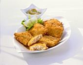Breaded, fried fish fillets