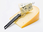 Pieces of Gouda and Gorgonzola with cheese knife