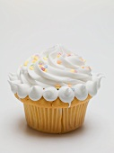 Cupcake with cream and sugar confetti