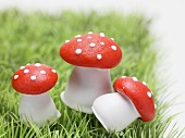 Lucky charms (fly agaric mushrooms) in grass