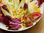 Mixed salad leaves with sweetcorn and tomato