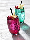 Two cocktails with redcurrants and star fruit