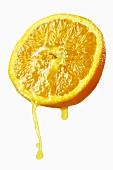 Half an orange dripping juice