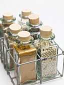 Various spices in small glass bottles
