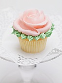 Rose muffin on glass cake stand