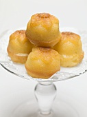 Rum babas on glass cake stand