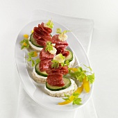 Salami and cucumber canapés