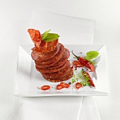 Tower of salami slices with chilli rings