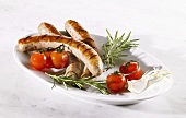 Grilled sausages with fresh tomatoes and rosemary