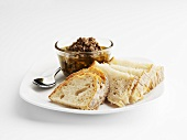 Tapenade and slices of bread on plate