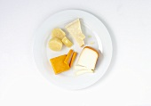 Various cheeses on plate (overhead view)