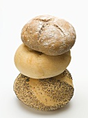 A poppy seed roll, a kaiser roll and a rye roll