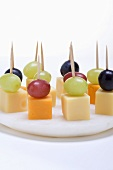 Cheese and grapes on cocktail sticks