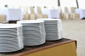 Pile of plates on a buffet table
