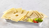 Several slices of Emmental cheese