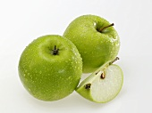 Granny Smith apples with drops of water