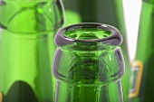 Green beer bottle necks (close-up)