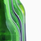 Green beer bottles in a row (detail)