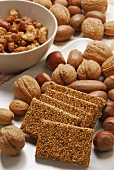 Sesame brittle, candied cashew nuts & peanuts beside nuts