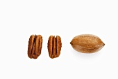 Pecans, two shelled, one unshelled