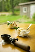 Ice Cream Scoop and Two Bowls of Ice Cream on Outdoor Table