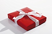 Red parcel with white ribbon