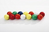 Coloured bubble gum balls in a row