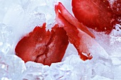 Sliced strawberry on ice (close-up)