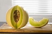 Honeydew Melon with Slice Removed to Show Seeds; With Slice