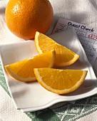 Fresh Orange Slices on Napkin on Dinner Check