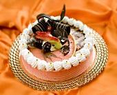 Sponge cake with fruit and chocolate decoration