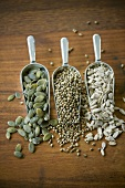 Pumpkin seeds, sesame seeds and hemp seeds in three scoops