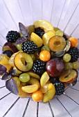 Fruit salad: plums, berries, grapes, physalis