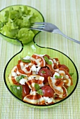 Coloured farfalle with tomatoes, mozzarella & salad leaves