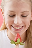 Woman looking at a strawberry