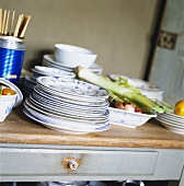 Plates, dishes and vegetables in a kitchen