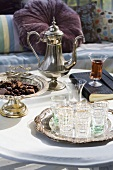 Teapot, glasses and chocolates