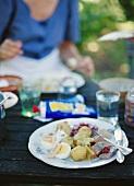Midsommar lunch: herring, eggs and potatoes (Sweden)