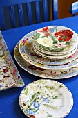 Flower-patterned plates on blue table