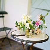Several vases of flowers on garden table