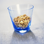 Salted peanuts in a glass