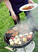 Person barbecuing food
