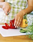 Slicing a red pepper