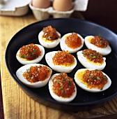 Boiled egg halves topped with caviar