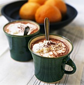 Hot chocolate with cream, oranges in background